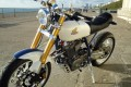 Jonda motorbike parked at the seafront.